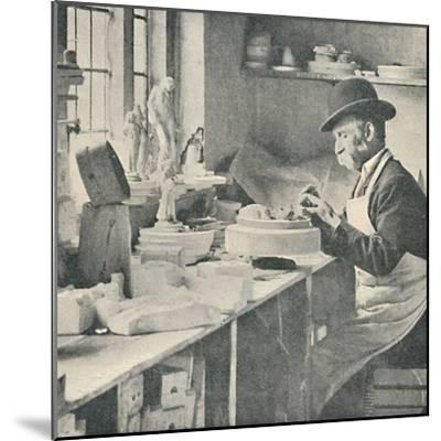 'Trimming up parts of raw clay', c1917-Unknown-Mounted Photographic Print