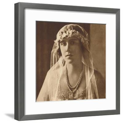 'Bridesmaid at wedding of Princess Mary and Viscount Lascelles, 1922', (1937.)-Unknown-Framed Photographic Print