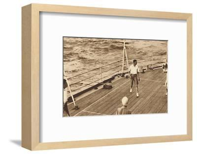 'Partners - A game of deck tennis in the Renown', 1927, (1937)-Unknown-Framed Photographic Print