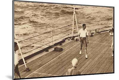 'Partners - A game of deck tennis in the Renown', 1927, (1937)-Unknown-Mounted Photographic Print