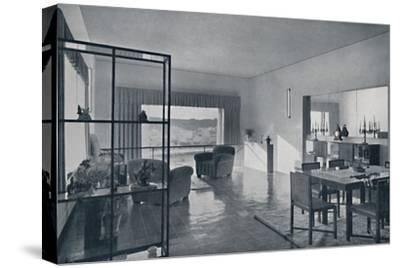 Paniconi and Pediconi. A dining room with a large window-Unknown-Stretched Canvas Print