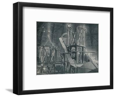 'Section By Section Mounts The Huge Steel Framework of the Hooker's Cylinder', c1935-Unknown-Framed Photographic Print