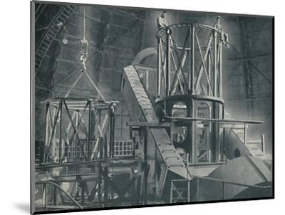 'Section By Section Mounts The Huge Steel Framework of the Hooker's Cylinder', c1935-Unknown-Mounted Photographic Print