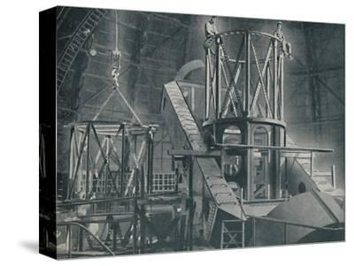 'Section By Section Mounts The Huge Steel Framework of the Hooker's Cylinder', c1935-Unknown-Stretched Canvas Print
