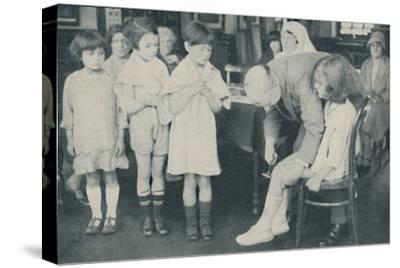 ' Testing the patella reflex for indication of nervous disease', c1935-Unknown-Stretched Canvas Print
