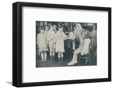 ' Testing the patella reflex for indication of nervous disease', c1935-Unknown-Framed Photographic Print
