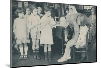' Testing the patella reflex for indication of nervous disease', c1935-Unknown-Mounted Photographic Print