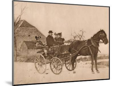 'Men and women in a horse-drawn carriage', 1937-Louis Guichard-Mounted Photographic Print