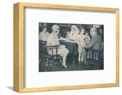 'The Doctor listening to a child's heart beat', c1935-Unknown-Framed Photographic Print