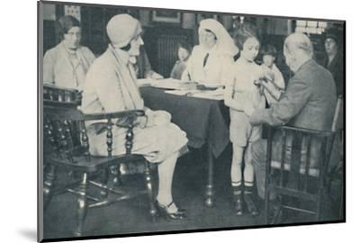 'The Doctor listening to a child's heart beat', c1935-Unknown-Mounted Photographic Print
