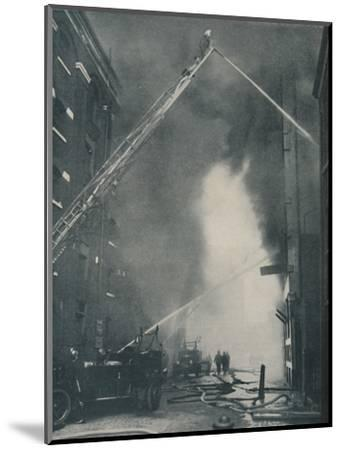 'Massed Forces of the Modern Fire-Fighter Pitted Against a City Blaze', c1935-Unknown-Mounted Photographic Print