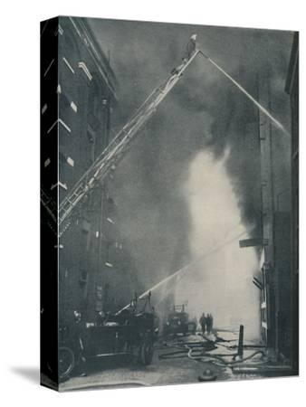 'Massed Forces of the Modern Fire-Fighter Pitted Against a City Blaze', c1935-Unknown-Stretched Canvas Print