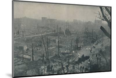 'Tokyo's Smouldering Plain of Wreckage and Ashes', c1935-Unknown-Mounted Photographic Print