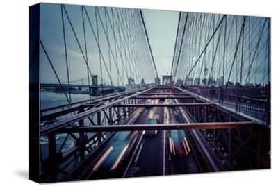 Traffic at Brooklyn Bridge, rainy evening, skyline of Manhattan, New York, USA-Andrea Lang-Stretched Canvas Print