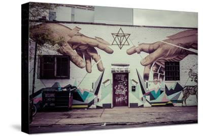 Graffiti of Michelangelo´s God and Adam´s hands in Williamsburg, Brooklyn, New York, USA-Andrea Lang-Stretched Canvas Print