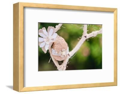 Branch, wrapped, jute cord, blossoms, Easter egg, close up,-mauritius images-Framed Photographic Print