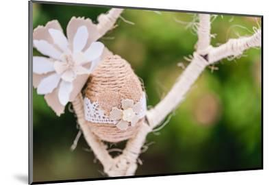 Branch, wrapped, jute cord, blossoms, Easter egg, close up,-mauritius images-Mounted Photographic Print