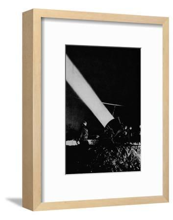 Elephant's child. A searchlight of 210,000,000 candle-power probes the night sky with its beam, 1-Unknown-Framed Photographic Print