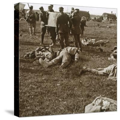 Burying bodies, Sainte-Marie-à-Py, northern France, c1914-c1918-Unknown-Stretched Canvas Print