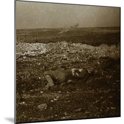 Body with barrage fire in the distance, c1914-c1918-Unknown-Mounted Photographic Print