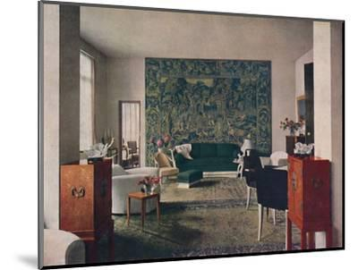 'Living-room designed by Porteneuve & Dominique, the end wall of which is hung with an old tapestry-Unknown-Mounted Photographic Print