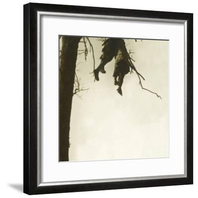 Body in tree, Bois d'Avocourt, Verdun, northern France, c1914-c1918-Unknown-Framed Photographic Print