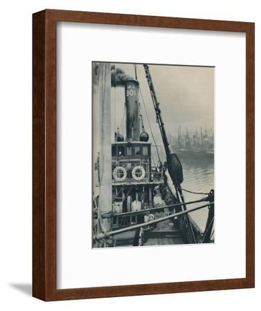 'Entering Grimsby Docks at the end of a North Sea voyage is the fishing vessel Saurian', 1937-Unknown-Framed Photographic Print