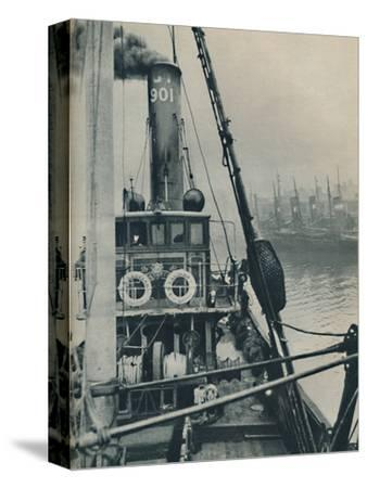 'Entering Grimsby Docks at the end of a North Sea voyage is the fishing vessel Saurian', 1937-Unknown-Stretched Canvas Print
