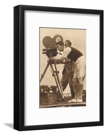 'Film-maker - Making a cinema record at one of his annual camps for boys', 1927 (1937)-Unknown-Framed Photographic Print