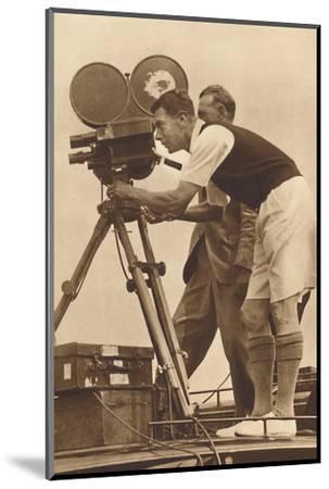 'Film-maker - Making a cinema record at one of his annual camps for boys', 1927 (1937)-Unknown-Mounted Photographic Print