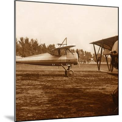 A plane taking off, c1914-c1918-Unknown-Mounted Photographic Print