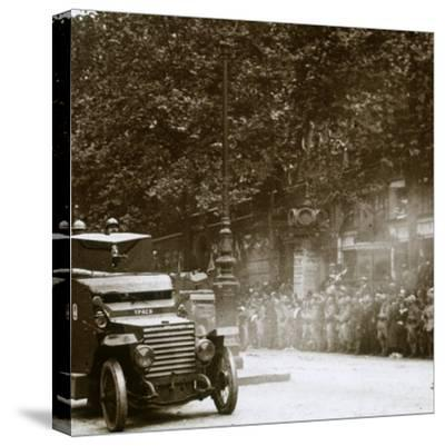 Machine gun mounted in armoured vehicle, victory parade, c1918-Unknown-Stretched Canvas Print