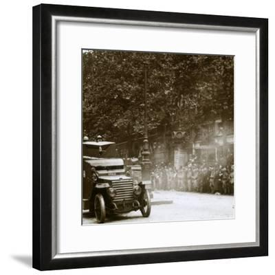 Machine gun mounted in armoured vehicle, victory parade, c1918-Unknown-Framed Photographic Print