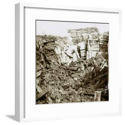 Aftermath of a shell, a soldier in the crater, c1914-c1918-Unknown-Framed Photographic Print