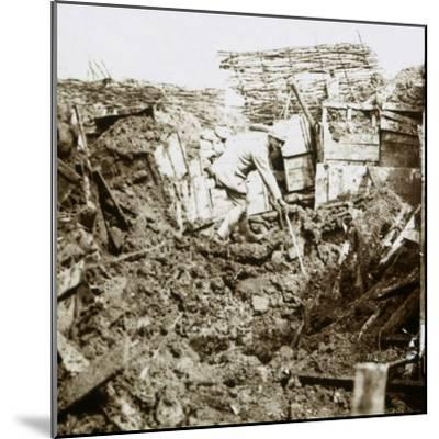 Aftermath of a shell, a soldier in the crater, c1914-c1918-Unknown-Mounted Photographic Print