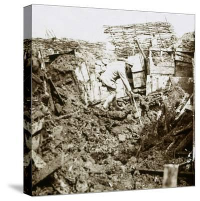 Aftermath of a shell, a soldier in the crater, c1914-c1918-Unknown-Stretched Canvas Print
