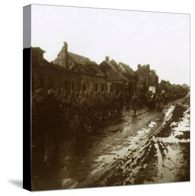 Soldiers marching past bombed-out houses, Champagne, northern France, c1914-c1918-Unknown-Stretched Canvas Print