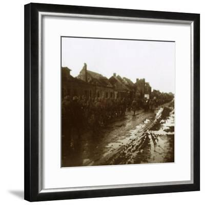 Soldiers marching past bombed-out houses, Champagne, northern France, c1914-c1918-Unknown-Framed Photographic Print