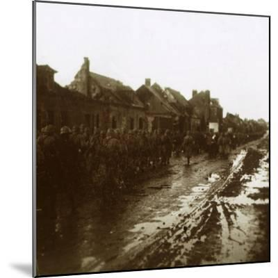 Soldiers marching past bombed-out houses, Champagne, northern France, c1914-c1918-Unknown-Mounted Photographic Print