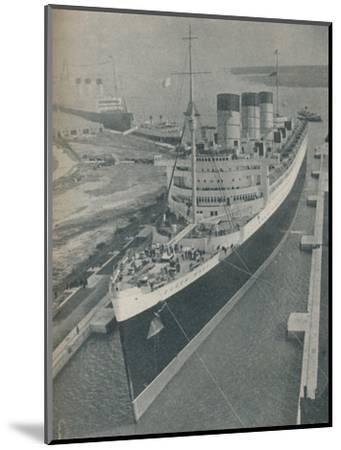 'Arrival of RMS Cunard White Star liner Queen Mary in King George V Graving Dock', 1936-Unknown-Mounted Photographic Print