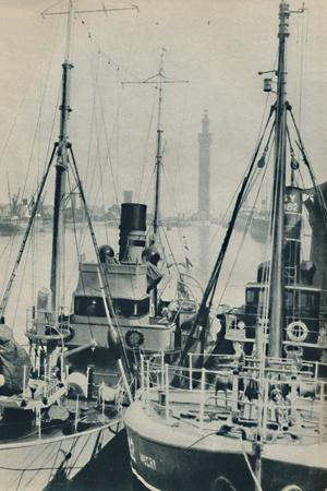 'Naval Trawler, HMS Liffy alongside a Grimsby fishing vessel in Grimsby Docks', 1937-Unknown-Framed Photographic Print