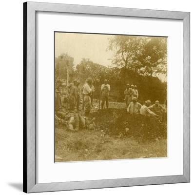 Burying the dead, c1914-c1918-Unknown-Framed Photographic Print