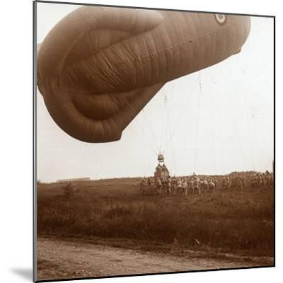 Raising of barrage balloon with basket for observation, c1914-c1918-Unknown-Mounted Photographic Print