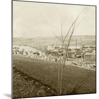 Column of trucks on the Voie Sacrée, Verdun, northern France, c1914-c1918-Unknown-Mounted Photographic Print