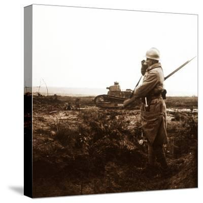 Tank and soldier on battlefield, c1914-c1918-Unknown-Stretched Canvas Print