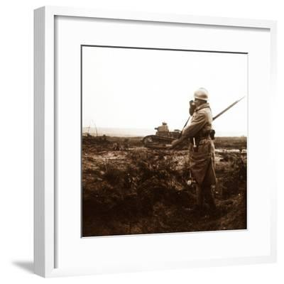 Tank and soldier on battlefield, c1914-c1918-Unknown-Framed Photographic Print