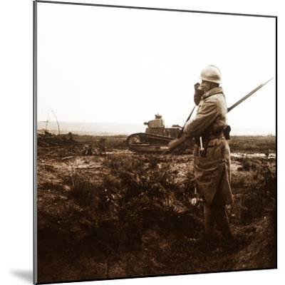 Tank and soldier on battlefield, c1914-c1918-Unknown-Mounted Photographic Print