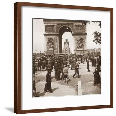 Victory celebration, civilians at the Arc de Triomphe, Paris, France, July 1919-Unknown-Framed Photographic Print