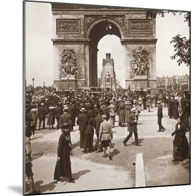 Victory celebration, civilians at the Arc de Triomphe, Paris, France, July 1919-Unknown-Mounted Photographic Print