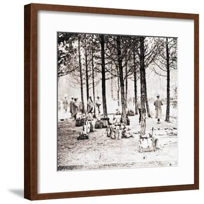 Soldiers and packs in woods, c1914-c1918-Unknown-Framed Photographic Print